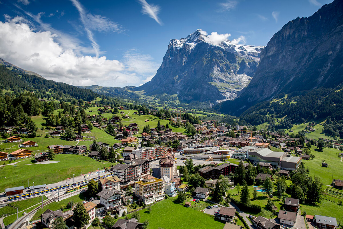 Grindelwald is a beautiful town in Switzerland. The picture shows popular train station and town